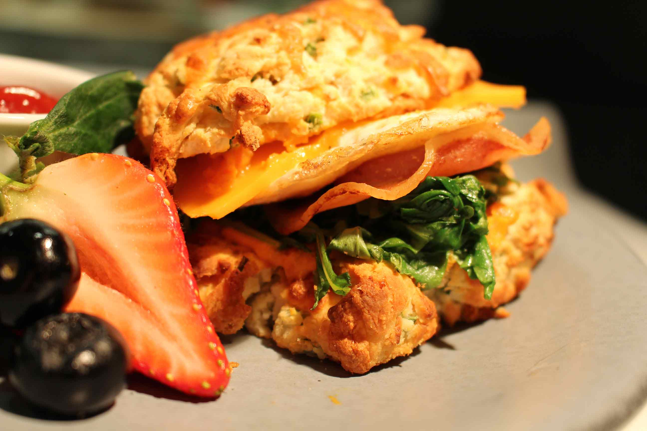 A sandwich made on a cheddar biscuit